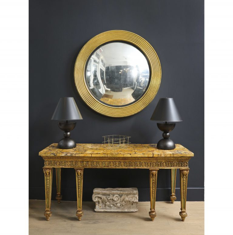 A Large Circular Giltwood Mirror with Silver Leafed Convex Glass