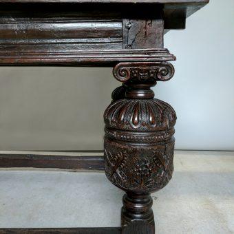 An Elizabethan Style Oak Draw-leaf Refectory Table