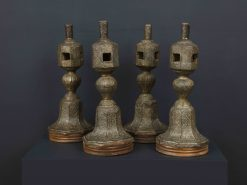 A Set of Four Large Copper Repousse Charpoy Legs