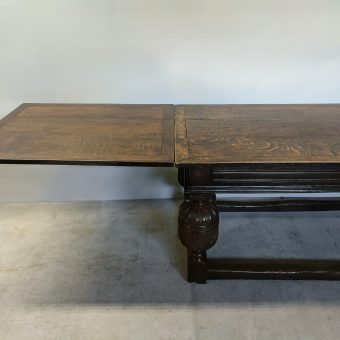 An Elizabethan Style Oak Draw-leaf Refectory Table